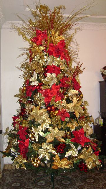 what happens when a poinsettia vomits in your living room and what is with the crown of fake golden prairie grass sprouting out of the top of the tree - Poinsettia Christmas Tree Decorations