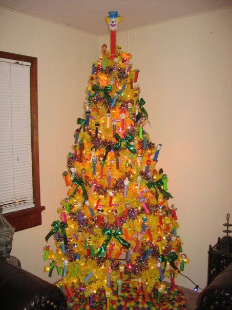 Yellow tree. Pez dispensers. Metalic green bows. I think I'm gonna hurl. - Mundanacity: Good, Bad, And Wickedly Ugly Christmas Trees 2009